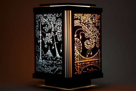 Decorative lamp with glowing ornamental pattern photo