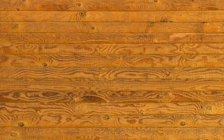 Wooden wall made of grained horizontal planks photo