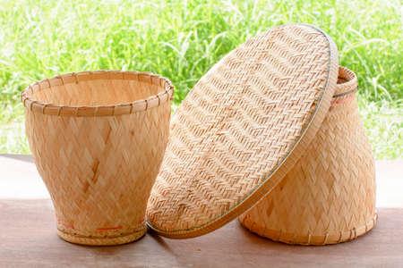 threshing: Basketwork contains earthenware steamer and threshing basket.