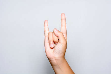 Boy Hand Show The Rock And Roll Sign Or Devil Horns Gesture On