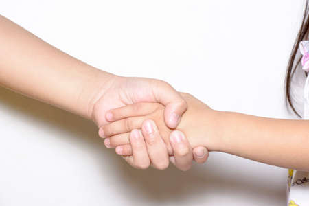 Shake hands between two peoples on white backgrounds that show negotiable or friendship.