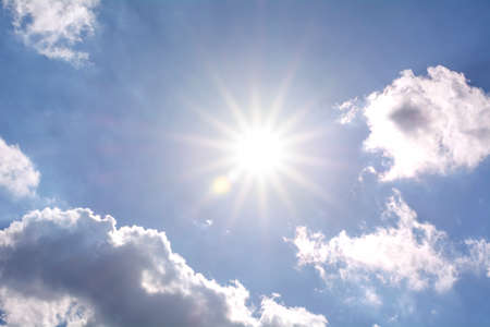 A blue sky with sun, sunbeams and clouds. Banco de Imagens - 44162351