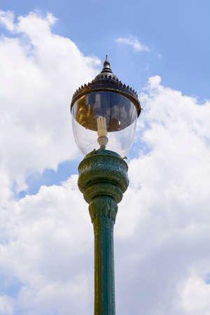 the grand palace: Metal street lamp with blue sky in grand palace, bangkok thailand