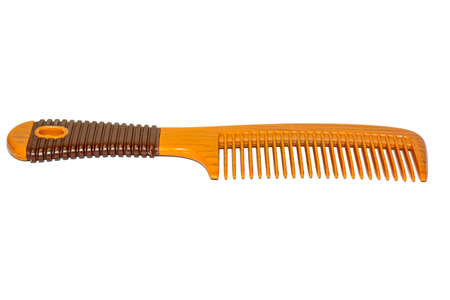comb hair: The brown hair comb on white background.