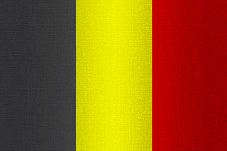 working stiff: Flag of Belgium on a stone wall background. Stock Photo