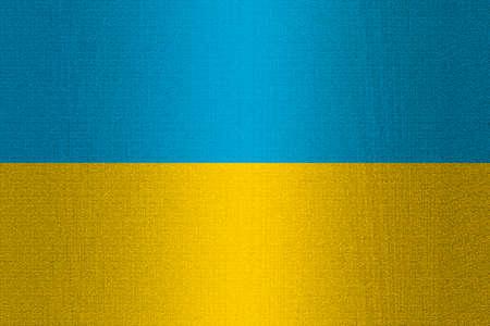 working stiff: Flag of Ukraine on a stone wall background.
