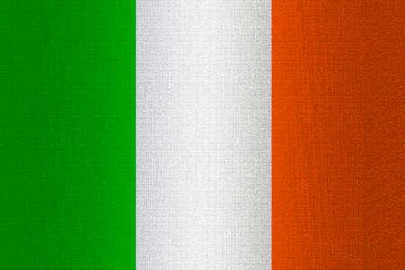 working stiff: Flag of Ireland on a stone wall background.