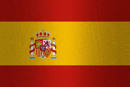 working stiff: Flag of Spain on a stone wall background.