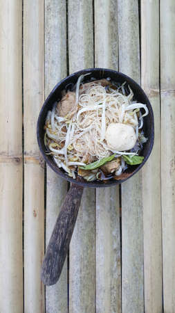 Noodles in thicken pork soup on the wood table. Stock Photo
