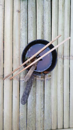 The noodles bowl on the wood table.