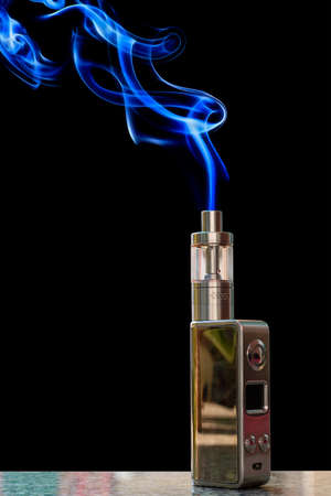 vaporizer: 3D electronic cigarette and smoke on the table rock on a black background.