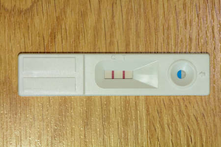 two people fertility: Positive pregnancy tests on a wood background. Stock Photo