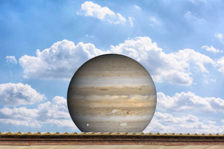 jupiter: Planet Jupiter on the roof, on the blue sky. Stock Photo
