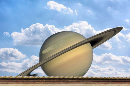 saturn rings: Planet Saturn on the roof, on the blue sky.