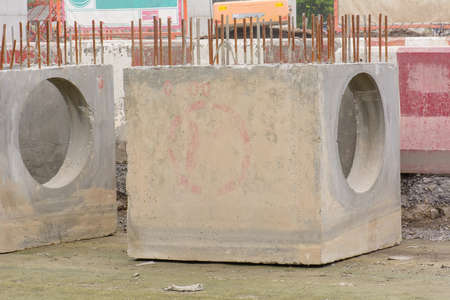 public waste: The precast concrete manholes waiting for use. Stock Photo
