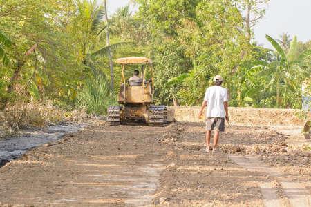Bulldozer is smooth soil in the garden. Stock Photo