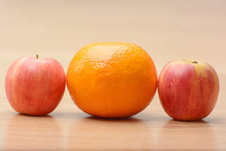 apples and orange shogun on the wood table. Stock Photo