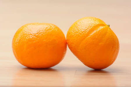 Two orange shogun on the wood table.