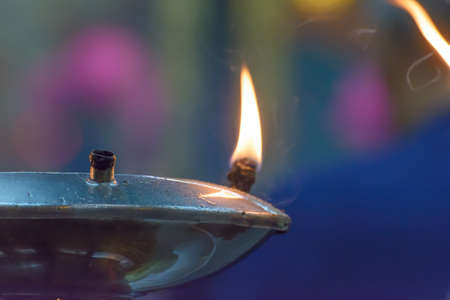 Light in the oil lamps. Its used in Buddhism.