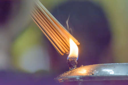 The incense of oil lamps. Its used in Buddhism.