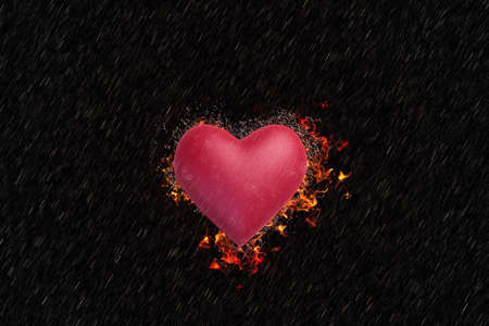burning paper: Valentine s Day style dark. The heart is burning in the rain.