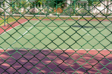 Tennis court in the area of the company. It is a good exercise. Stock Photo
