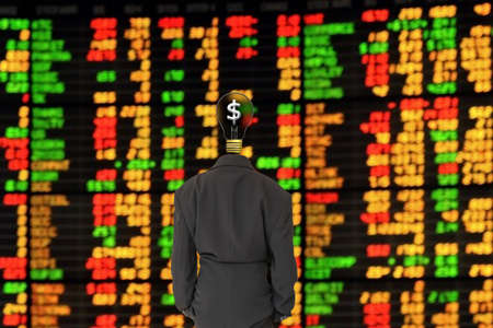 Businessman looking trading stocks.