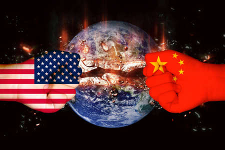 Flags of USA and China on hand on planet world bombs background/usa china trade war concept. Фото со стока
