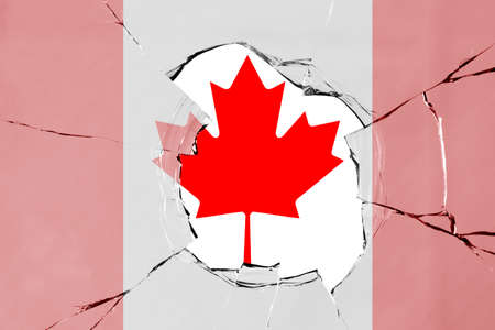 Flag of Canada on a on glass breakage.