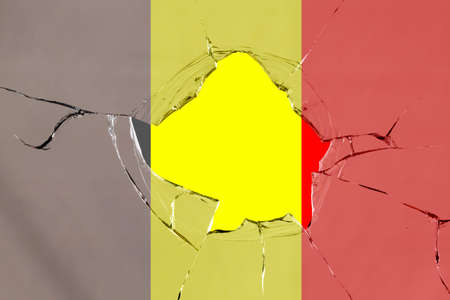 Flag of Belgium on a on glass breakage.