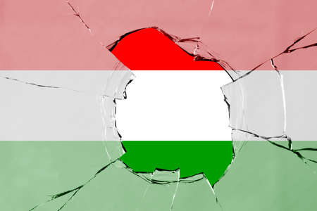 Flag of Hungary on a on glass breakage. 版權商用圖片