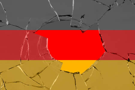 Flag of Germany on a on glass breakage. 版權商用圖片