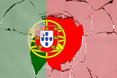 Flag of Portugal on a on glass breakage. 版權商用圖片