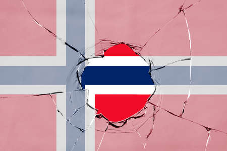 Flag of Norway on a on glass breakage.
