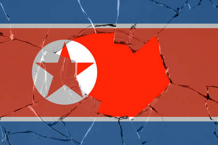 Flag of North Korea on a on glass breakage.