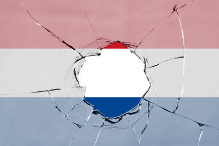 Flag of Netherland on on glass breakage.