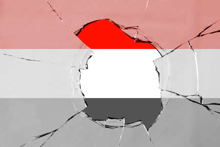 Flag of Yemen on a on glass breakage. 版權商用圖片 - 131723365