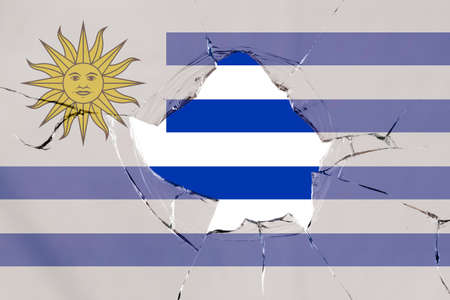 Flag of Uruguay on a on glass breakage.