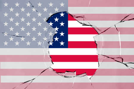 Flag of United States of America on a on glass breakage.