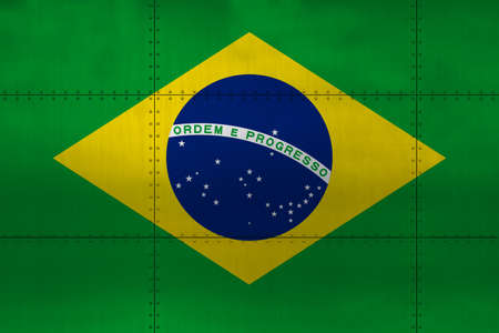 Flag of Brazil on a metal wall background.