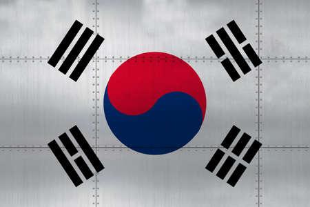 Flag of South Korea on a metal wall background.