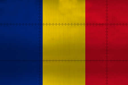 Flag of Romania on metal wall background.