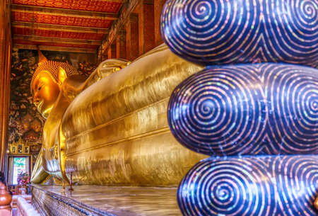 A large Reclining Buddha is one landmark of Wat Phra Chettuphon Wimon Mangkhalaram Ratchaworamahawihan in Bangkok, Thailand. A place everyone in every religion can be viewed.