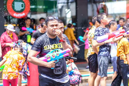 Siam Square, Bangkok, Thailand - APR 13, 2019: short action of people joins celebrations of the Thai New Year or Songkran in Siam Square. Editorial
