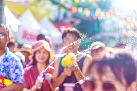 Songkran Festival or Songkran is celebrated in Thailand as the traditional New Year's Day from 13 to 15 April. People getting soaked during Songkran. Banco de Imagens