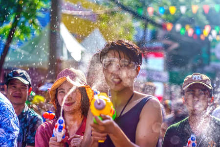 Siam Square, Bangkok, Thailand - APR 13, 2019: short action of people joins celebrations of the Thai New Year or Songkran in Siam Square. 新聞圖片