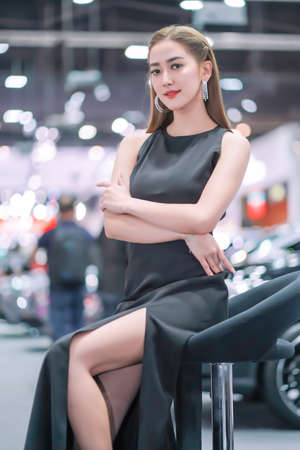 Nonthaburi, Thailand - DEC 3, 2019: Unidentified model poses with a car at The 36th Motor Expo Thailand 2019 at IMPACT Arena, Muang Thong Thani, Nonthaburi, Thailand. 新聞圖片