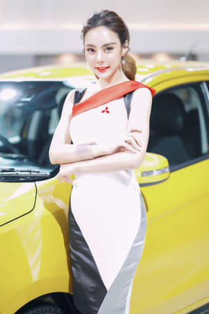 Nonthaburi, Thailand - DEC 3, 2019: Unidentified model poses with a car at The 36th Motor Expo Thailand 2019 at IMPACT Arena, Muang Thong Thani, Nonthaburi, Thailand. Editorial