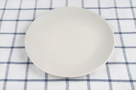 checkered tablecloth: Empty plate at classic checkered tablecloth Stock Photo