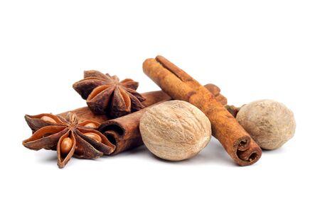 anise, nutmeg and cinnamon isolated on white  photo